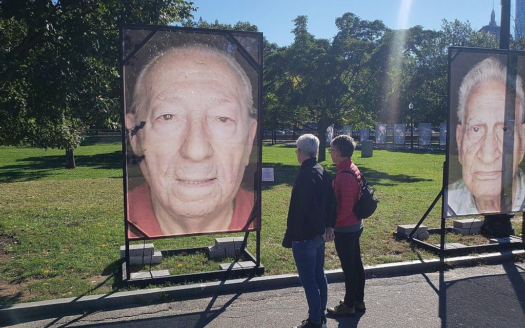 Staged in Boston Common, the 'Lest We Forget' Holocaust remembrance installation includes a photograph of survivor Israel 'Izzy' Arbeiter, Boston, Massachusetts, October 16, 2018 (Matt Lebovic/The Times of Israel)