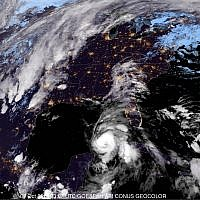 This satellite image provided by the National Oceanic and Atmospheric Administration shows a view of Tropical Storm Michael, lower right, churning as it heads toward the Florida Panhandle, early on October 9, 2018. (NOAA)