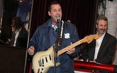 Adam Sandler plays at a benefit concert in Los Angeles, March 3, 2018 (Jerritt Clark/Getty Images for Artists for Peace and Justice via JTA)