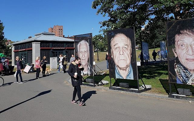 'Lest We Forget' installation of Holocaust survivor portraits in Boston Common, Boston, Massachusetts, October 16, 2018 (Matt Lebovic/The Times of Israel)