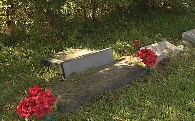 Screen capture from video of toppled headstones at the Hebrew Rest Cemetery, in Orange, Texas. (YouTube)