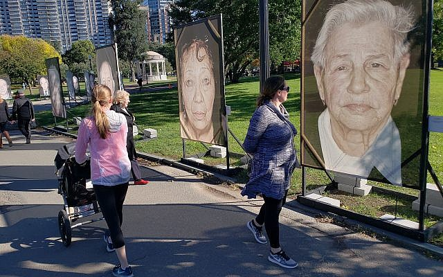 Illustrative: The Boston installation of 'Lest We Forget,' a Holocaust remembrance project centered on survivor photographs taken by Luigi Toscano, October 16, 2018 (Matt Lebovic/The Times of Israel)