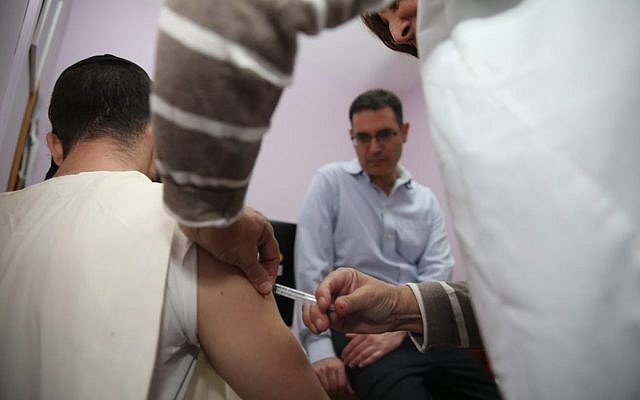 Illustrative: A patient getting a measles vaccination in Jerusalem in November, 2018. (courtesy Health Ministry)