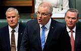 Australia's Prime Minister Scott Morrison (C) delivers a speech in the House of Representatives in Parliament House in Canberra on October 22, 2018. (Sean Davey / AFP)