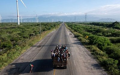 Migrants -mostly Hondurans- heading in a caravan to the US, ride on a truck on the road from La Ventosa to Matias Romero, Oaxaca State, Mexico, on November 1, 2018. (Guillermo Arias / AFP)