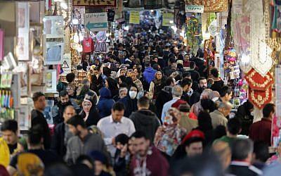 Illustrative: Iranians shop in the capital Tehran's grand bazar on November 3, 2018. (ATTA KENARE / AFP)