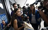 Democratic congressional candidate Alexandria Ocasio-Cortez, left, speaks with  reporters after her general campaign kick-off rally in the Bronx borough of New York, September 22, 2018. (Don EMMERT/AFP)