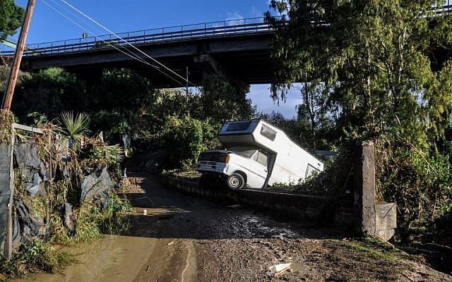 A motorhome is pictured off side of a flooded road on November 4, 2018 near a house where nine people of the same family died after a small river burst its banks in Casteldaccia near Palermo on the southern Italian island of Sicily. (Alessandro FUCARINI / AFP)