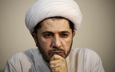 In this file photo taken on November 20, 2014, Bahrain's Al-Wefaq opposition group leader Sheikh Ali Salman looks on during a rally against the upcoming parliamentary election in the village of Zinj, south of Manama, Bahrain. (Mohammed Al-Shaikh/AFP)
