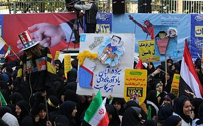 Iranian protesters demonstrate outside the former US Embassy in the Iranian capital Tehran on November 4, 2018, marking the anniversary of its storming by student protesters that triggered a hostage crisis in 1979. (ATTA KENARE/AFP)