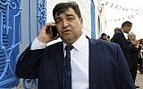 In this file photo taken on May 02, 2018, Rene Trabelsi speaks on the phone outside the Ghriba Synagogue on the Tunisian resort island of Djerba. (FETHI BELAID / AFP)