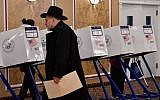 A voter casts his ballot at the East Midwood Jewish Center polling station in the Brooklyn borough of New York City on November 6, 2018. (Angela Weiss / AFP)