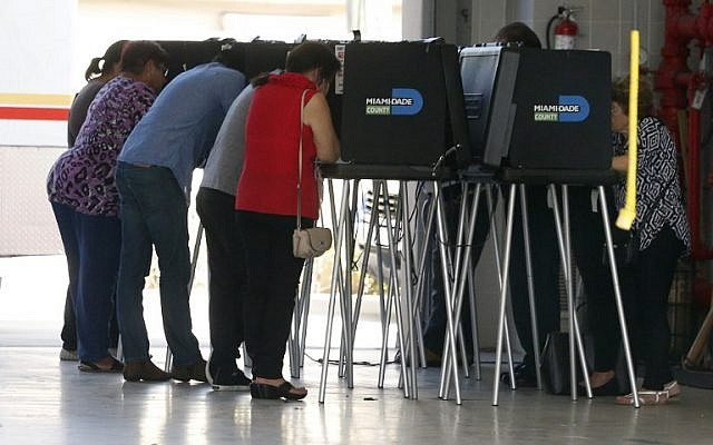South Florida voters cast their ballots at a polling center in Miami, Florida on November 6, 2018. (RHONA WISE / AFP)