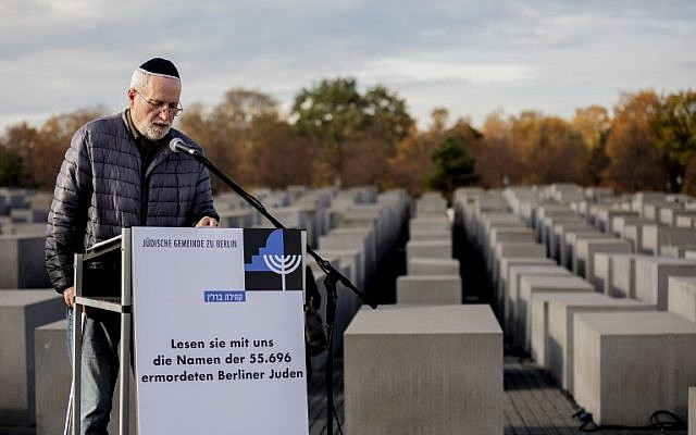 Gerhard Schmidt-Grillmeier reads names of 55,696 Jews from Berlin who were killed by the Nazis during a commemoration ceremony on November 8, 2018 at the Memorial to the Murdered Jews of Europe (Holocaust Memorial) in Berlin. (Photo by Christoph Soeder / dpa / AFP)