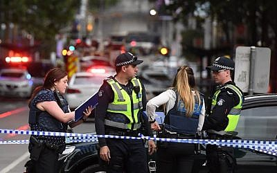 Police work at the crime scene following a stabbing incident in Melbourne on November 9, 2018. (William West/AFP)