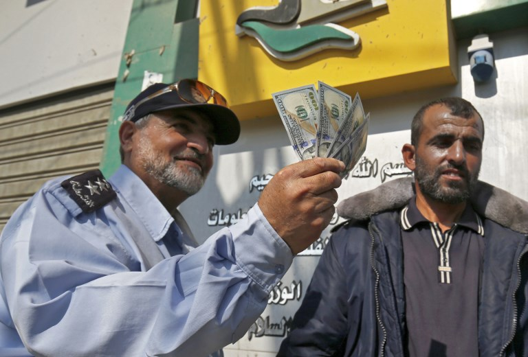 Hamas workers collect salaries as Qatar injects more cash into Gaza