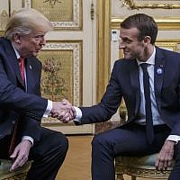 US President Donald Trump (L) shakes hands with French President Emmanuel Macron prior to their meeting at the Elysee Palace in Paris, on November 10, 2018. (Christophe Petit-Tesson/Pool/AFP)