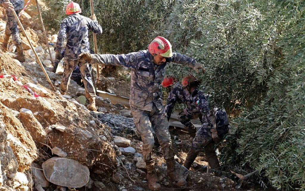 Death toll in Jordan flash floods up to 13 after girl's body found