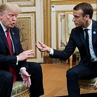 US President Donald Trump (L) speaks with French President Emmanuel Macron prior to their meeting at the Elysee Palace in Paris, on November 10, 2018, on the sidelines of commemorations marking the 100th anniversary of the 11 November 1918 armistice ending World War I. (Photo by SAUL LOEB / AFP)