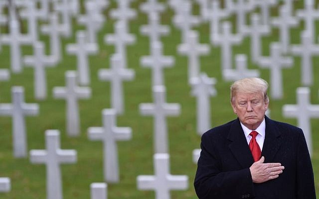 US President Donald Trump takes part in a ceremony at the American Cemetery of Suresnes, outside Paris, on November 11, 2018 as part of Veterans Day and commemorations marking the 100th anniversary of the 11 November 1918 armistice, ending World War I. (SAUL LOEB / AFP)