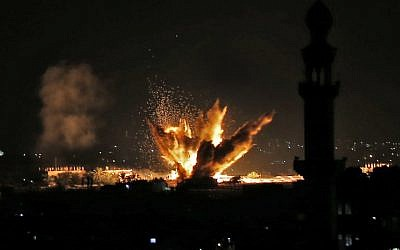 Fire and smoke billow following Israeli air strikes targeting Rafah in the southern Gaza Strip, near the border with Egypt, on November 12, 2018.  (Said KHATIB / AFP)