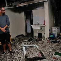 An Israeli inspects the damage in an apartment that was hit by a rocket fired from the Gaza Strip, in the southern Israeli town of Ashkelon on November 12, 2018.  (GIL COHEN-MAGEN / AFP)