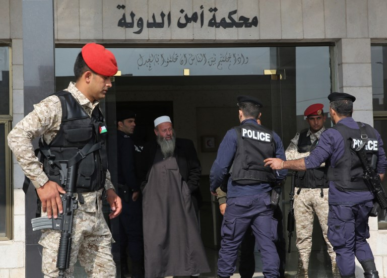 Jordanian security forces stand guard outside a military court as members  of a jihadist cell accused 62a1c51fefe