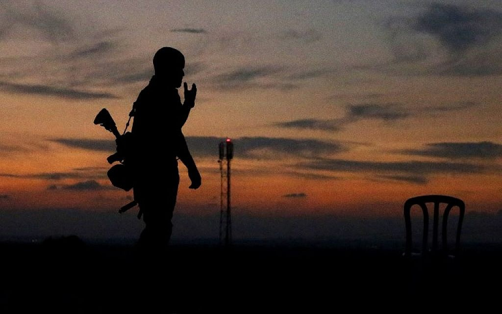 The silhouette of an Israeli soldier is pictured in the southern Israeli town of Sderot on November 13, 2018.(JACK GUEZ / AFP)