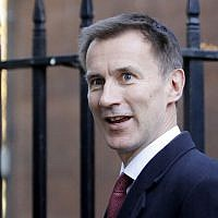 Britain's Foreign Secretary Jeremy Hunt leaves 10 Downing Street in London on November 14, 2018.  ( Tolga AKMEN / AFP)