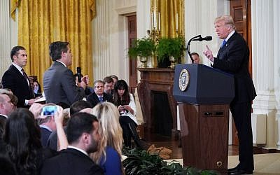 US President Donald Trump, right, gets into a heated exchange with CNN chief White House correspondent Jim Acosta, center, during a post-election press conference in the East Room of the White House in Washington, DC, November 7, 2018. (MANDEL NGAN/AFP)