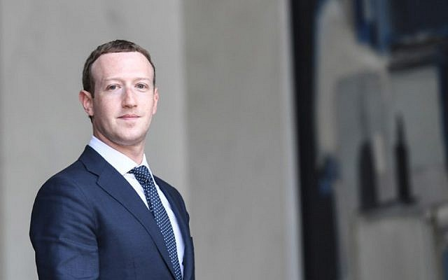 Facebook's CEO Mark Zuckerberg leaves the Elysee presidential palace in Paris, France, following a meeting with French President Emmanuel Macron during the 'Tech for Good' summit, May 23, 2018. (Alain Jocard/AFP)