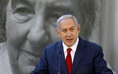 Prime Minister Benjamin Netanyahu speaks at a memorial ceremony for former premier Golda Meir at Mount Herzl cemetery in Jerusalem on November 18, 2018. (Menahem Kahana/AFP)