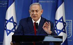Prime Minister Benjamin Netanyahu gives a press conference at Defense Ministry headquarters in Tel Aviv on November 18, 2018. (Jack Guez/AFP)