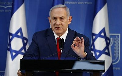 Prime Minister Benjamin Netanyahu gives a press conference at Defense Ministry headquarters in Tel Aviv on November 18, 2018. (Jack Guez/AFP)