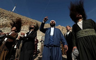 Iraqi Sufi Muslim Kurds take part in a ritual ceremony to commemorate the birth of the Prophet Mohammed in the Kurdish town of Akra, 500 km north of Baghdad, on November 19, 2018. (SAFIN HAMED / AFP)