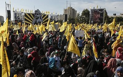 Palestinians in Gaza participate in a rally organized by Fatah dissidents to mark the 14th anniversary of former Palestinian Authority President Yasser Arafat's death on November 20, 2018. (Photo by MAHMUD HAMS / AFP)