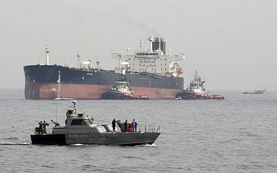 An Iranian military speedboat patrols the waters as a tanker prepares to dock at the oil facility in the Khark Island, Iran, March 12, 2017. (Atta Kenare/AFP)