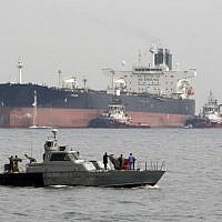 An Iranian military speedboat patrols the waters as a tanker prepares to dock at the oil facility on Khark Island, Iran, on March 12, 2017. (Atta Kenare/AFP)