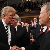 In this file photo taken on February 28, 2017, US President Donald Trump, left, shakes hands with US Supreme Court Chief Justice John Roberts as Trump arrives to deliver his first address to a joint session of Congress in Washington, DC. ( JIM LO SCALZO / POOL / AFP)