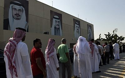 Bahraini voters queue outside a polling station in the Bahraini city of Al-Muharraq, north of Manama on November 24, 2018, as they wait to cast their vote in the parliamentary election. (AFP)