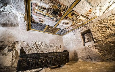 This picture taken on November 24, 2018 shows a carved black wooden sarcophagus inlaid with gilded sheets, dating to Egypt's Late period (7th-4th century BC), lying in a burial chamber decorated with colored scenes depicting the owner with members of his family, discovered by an Egyptian archaelogical mission at the site of Tomb TT28 at Al-Assasif  necropolis on the west bank of the Nile north of the southern Egyptian city of Luxor. (Khaled DESOUKI / AFP)