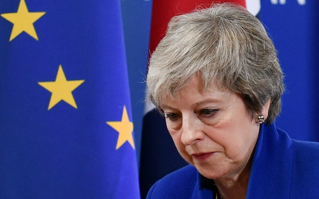 Britain's Prime Minister Theresa May leaves after a press conference following a special meeting of the European Council to endorse the draft Brexit withdrawal agreement and to approve the draft political declaration on future EU-UK relations on November 25, 2018 in Brussels. (Photo by Philippe LOPEZ / AFP)