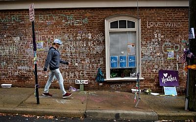 A man walks past a memorial to Heather Heyer and the other victims of last year's hit and run a few blocks away the first day of jury selection for James Fields's murder trial at the Charlottesville Circuit Court, November 26, 2018 in Charlottesville, Virginia. (Brendan Smialowski / AFP)