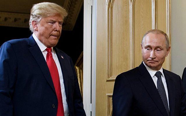 Illustrative: US President Donald Trump, left, and Russian President Vladimir Putin arrive for a meeting in Helsinki, Finland, on July 16, 2018. (Brendan Smialowski/AFP)
