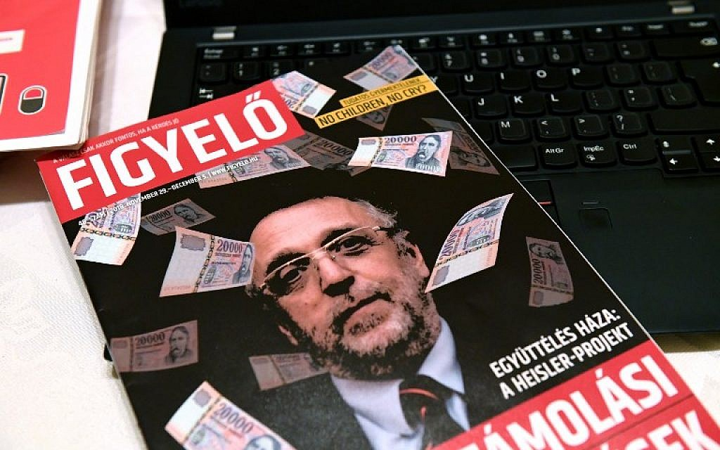 The cover of Hungarian magazine 'Figyelo' (Attention) with a portrait of Andras Heisler, head of the Federation of Hungarian Jewish Communities (Mazsihisz) is pictured on November 30, 2018, in Budapest. Hungary's largest Jewish organization has condemned  'incitement' against its leader after he was depicted on the cover of a prominent pro-government weekly surrounded by banknotes. (Attila Kisbenedek/AFP)