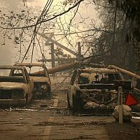 Power lines rest on cars that were burned by the Camp Fire on November 10, 2018 in Paradise, California.  (Justin Sullivan/Getty Images/AFP)