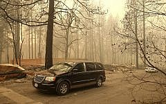 A hearse carries the remains of two deceased victims of the Camp Fire on November 10, 2018 in Paradise, California.  (Justin Sullivan/Getty Images/AFP)