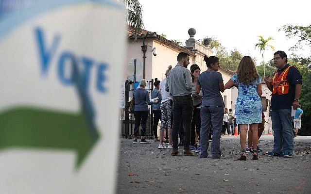 Voters line up to cast their ballot just before the polls open in the mid-term election