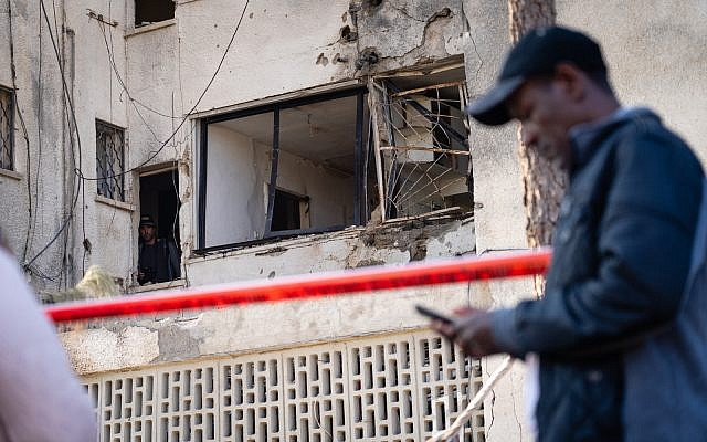 An apartment building in Ashkelon hit by a Hamas rocket, killing one, November 13, 2018. (Luke Tress/Times of Israel)