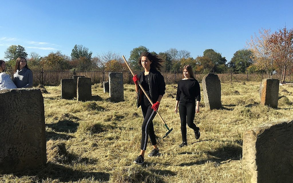 Students at the local high school participated in the Day of Action Clean-Up at the Kalush Jewish Cemetery. (Marla Raucher Osborn/ Rohaytn Jewish Heritage)Marla Raucher Osborn/ Rohaytn Jewish Heritage)